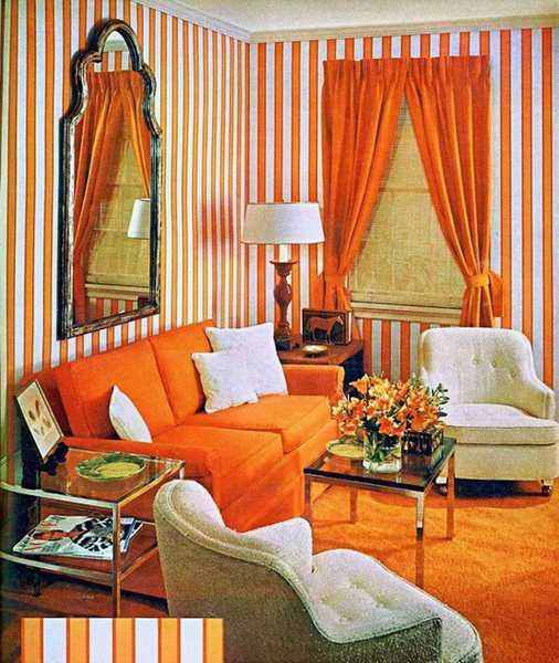 orange sofa cushions window curtains and atriped wallpaper