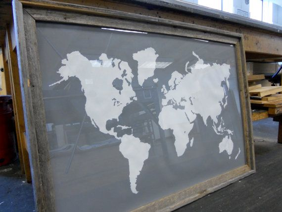 Love the modern print in a vintage/worn looking frame. Giant Modern World Map Print Poster - 24x36 - Gray and White. $48.00, via Etsy.