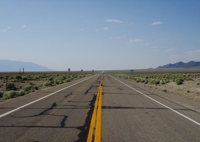 Favorite Travel Photographs Features A Lonely Stretch of Desert Highway - See more @gr8traveltips