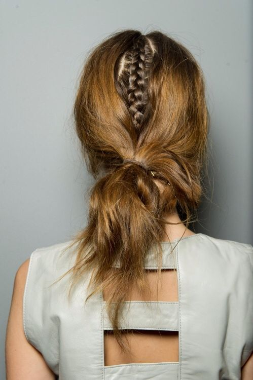 Great and different hairstyle! A bit more edgy than a normal messy bun.
