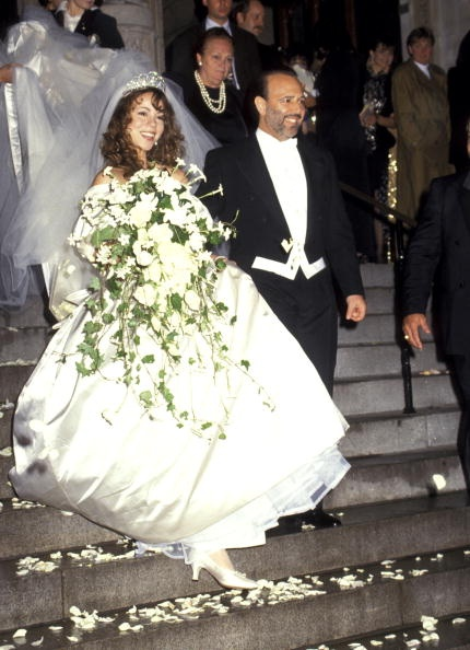 Biggest Flower Arrangement: Mariah Carey.  For Careys first marriage to Tommy Mottola, it looks like she grabbed an alter piece instead of her bouquet.