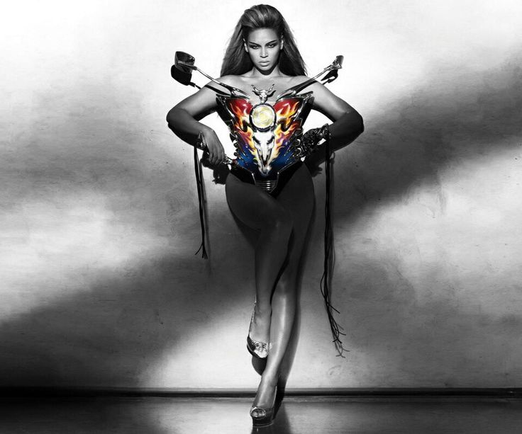 "Beyonce wearing a metal corset with the face of Baphomet on it, which is also ""adorned with stylish rear-view mirrors and motorcycle handles, which makes Sasha Fierce the vehicle of Baphomet."""
