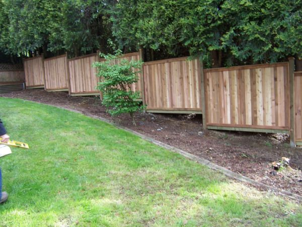 Building A Fence On Sloped Ground Fences And Gates