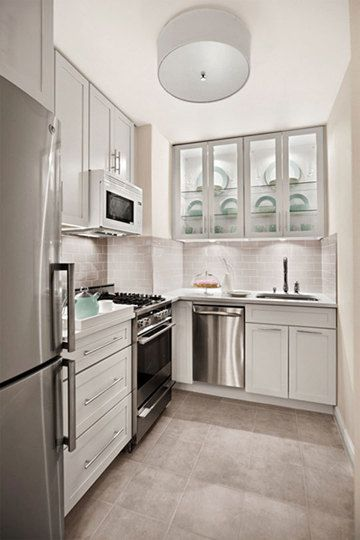 Love the frosted glass on the cabinet doors.  From Apartment Therapy - Our 10 Favorite Small Kitchens  Inspirationalsmallkitchens_08_rect540