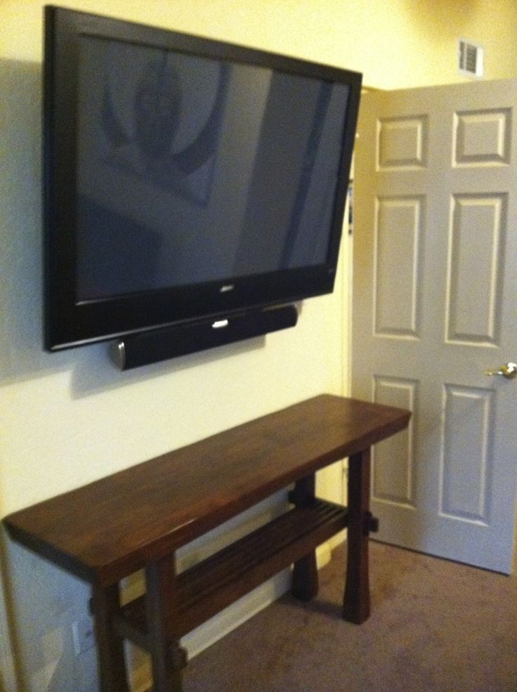 TV mounted in the bedroom with a soundbar mounted close