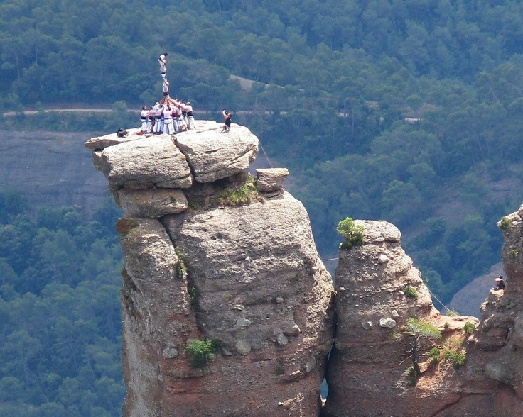"""Human towers in the top of a mountain by """"Minyons de Terrassa""""."""