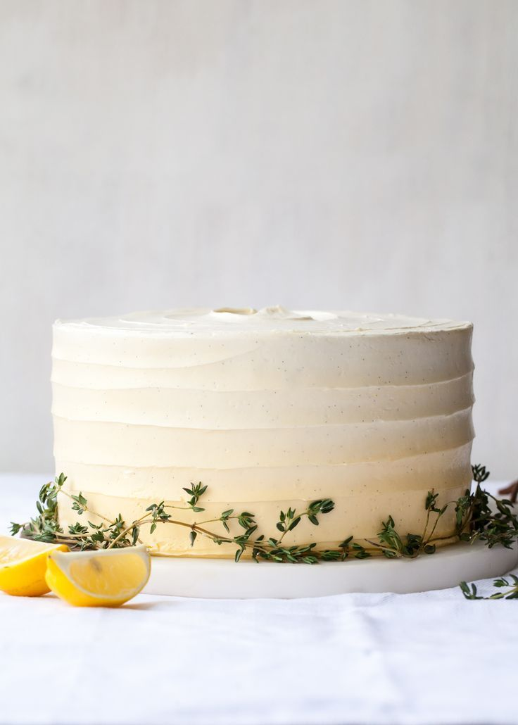 Citrus and herbs go hand in hand in this vibrant Lemon Thyme Cake.  Light   lemon cake if flecked with fresh thyme and layered with lemon buttercream.    Add a ripple of homemade lemon curd for an extra pop of flavor and   decorate with fresh thyme for a simple, rustic look.    Perhaps one day my well of cake ideas will run dry, but thankfully that day   is not today.  Being able to incorporate seasonal ingredients and savoury   herbs into sweet treats keeps the creativity following, and…