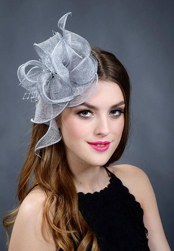 Silver fascinator. Silver wedding fascinator. Silver fascinator hat. Silver headpiece. Silver Ascot hat. Silver Derby hat. Mounted on a thin silver headband. Trimmed with silver netting. This listing is ONLY FOR THE FASCINATOR. New! Accomplish your fascinator now with a pair of