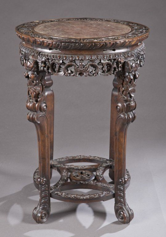 A Chinese hardwood round taboret stand. 19th century.
