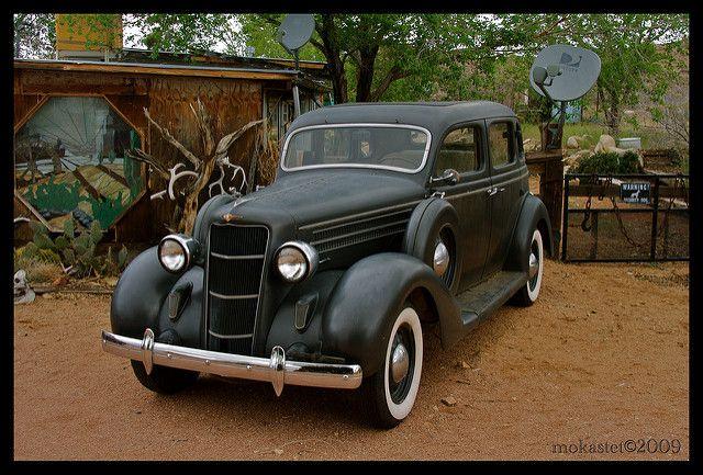 A Noble Black 1935 Dodge Sedan.