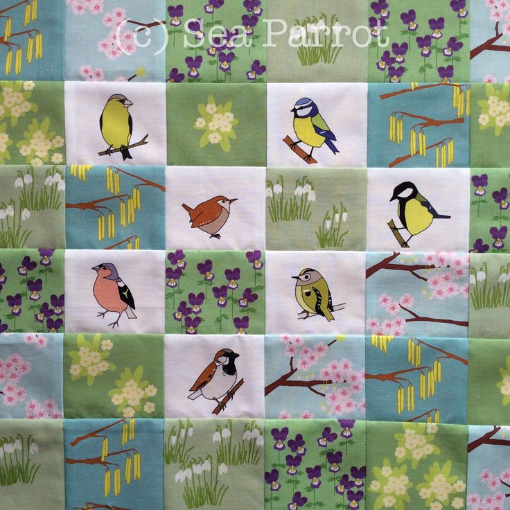 A patchwork made using my original spring garden design fabric. Garden birds (greenfinch, blue tit, wren, great tit, chaffinch, goldcrest and house sparrow) combined with spring flowers (cherry blossom, catkins, primroses, snowdrops and wild pansies). You can buy the fabric online from my Folksy shop or contact me.