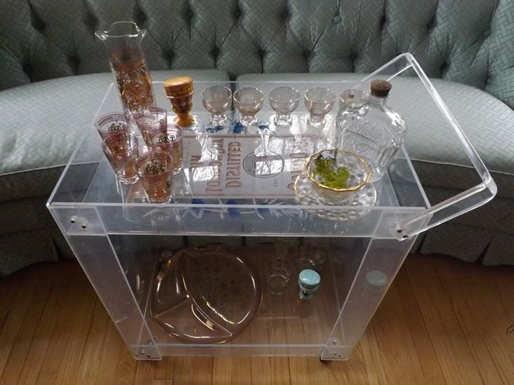 28.5 inches high, 24 inches long and 15.5 inches wide. This is a very nice, lucite bar cart, in very good vintage condition. Scratching is very minimal considering that this is at least 40 years ol...
