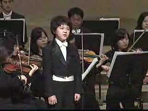 """In direct contrast to the terrible forcing of 11 year old Jacopo Menconi who imitates an """"adult sound"""", this little boy soprano of the same age is beautifully balanced, musical and natural and...he is himself."""