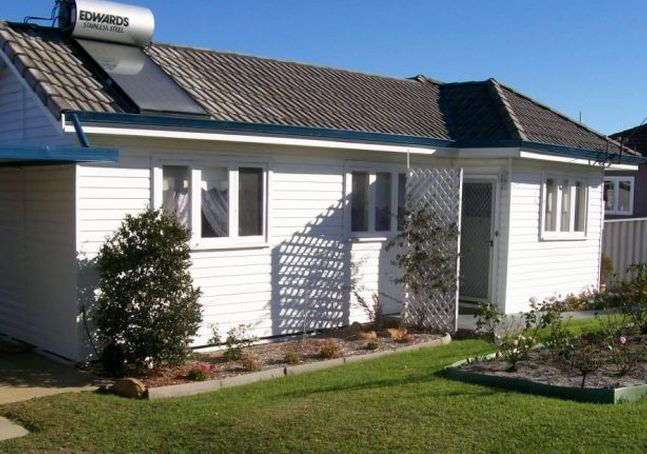 63 David Street is home to a quaint cottage with a white picket fence.