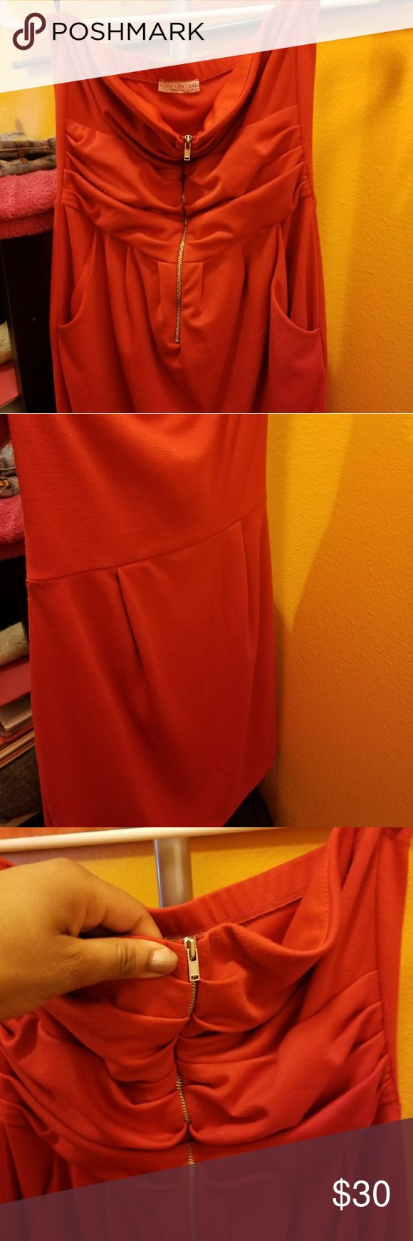 Pretty Red-orange Mini Dress A tube dress that is vivid red (with a slight orangey tint). It is short, zips in the front, and has pockets. Very cute. Body Central Dresses Mini