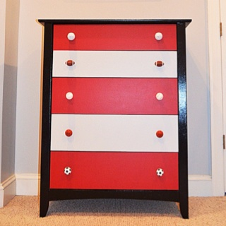 painted a white dresser to make this sports theme dresser for a new big boy