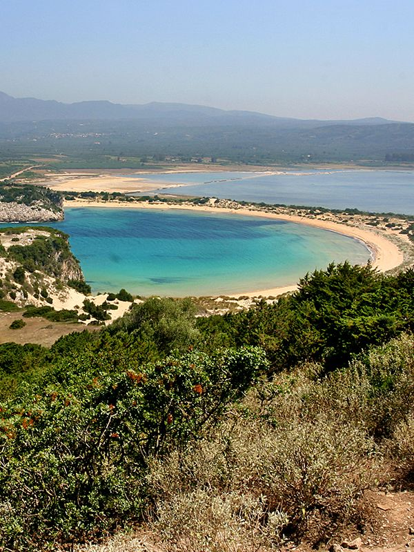 "Voidokilia Beach is a popular beach in Messinia. In the shape of the Greek letter omega, its sand forms a semicircular strip of dunes. On the land-facing side of the strip of dunes is Gialova- or Divari Lagoon, an important bird habitat. The beach has been named ""A Place of Particular Natural Beauty"". It is part of a Natura 2000 protected area. #voidokiliabeach #gialova #divarilagoon #gialovalagoon #voidokilia #messenia #pylos #peloponnese #greece"