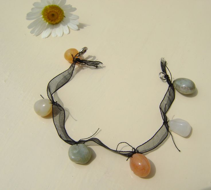 bracelet made from little stones, tied up on a black ribbon!