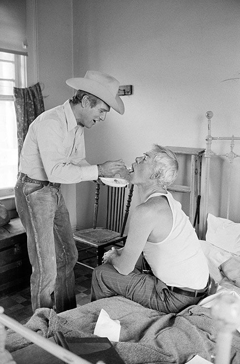 American actor Paul Newman spoonfeeds Lee Marvin, his co-star in Stuart Rosenberg's 1972 comedy western 'Pocket Money', Tuscon, Arizona.