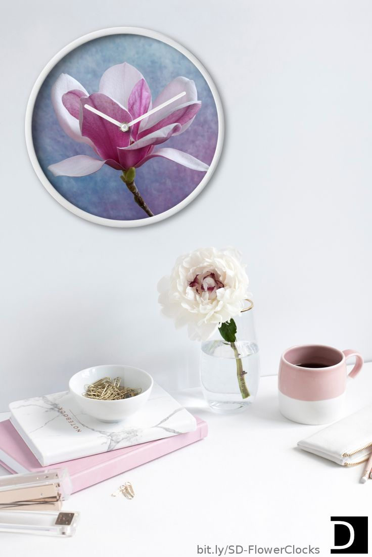 Add a beautiful touch to any empty wall space with this round wall clock which features a pretty pink Chinese Magnolia flower. #StudioDalio #floraldesign #flowerpower #clocksforhome #clocksdesign #wallclockforlivingroom #wallclockforbedroom #wallclockdesigns #timepieces #redbubble #redbubbleartist