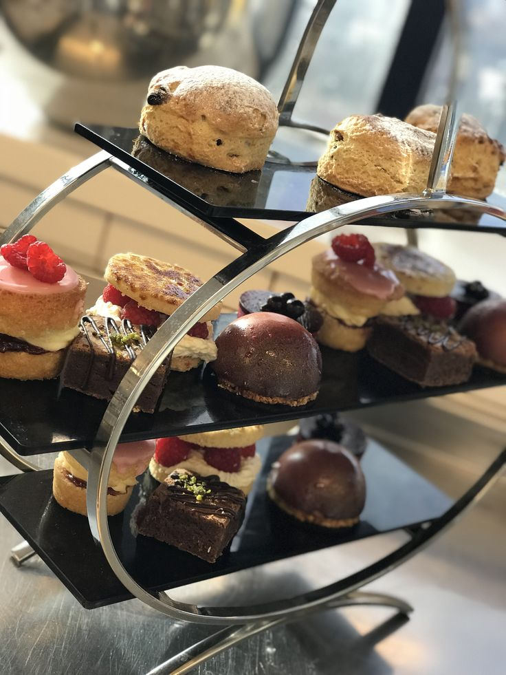 Selection of Afternoon Tea Cakes - Mini Victoria Sandwich  - Pistachio and Chocolate Brownie - Blackcurrant Delice - Coconut Bavarois  - Strawberry and Cream Shortbread