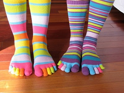 I swear one of my missions in life is to make toe socks cool again.