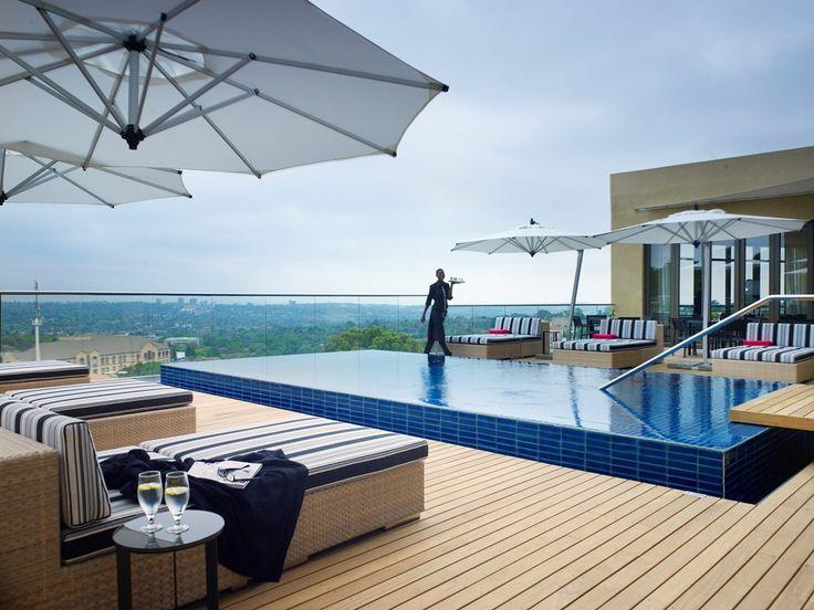 Southern Sun Hotel Pool Deck. Interior design by Source Interior Brand Architecture.