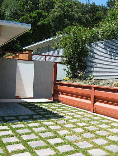 Contemporary design with steel and stone elements and then all brought together with the element of grass. Like.