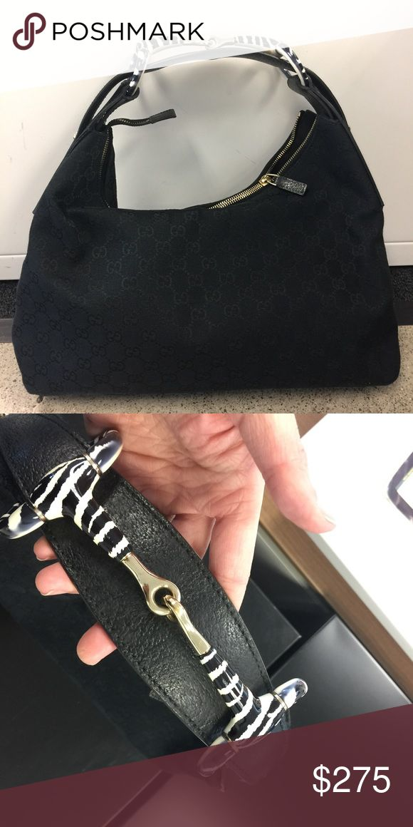 Gucci monogram canvas hobo with zebra handle Authentic Gucci Bag with sassy zebra horsebjt handle.  Good condition, comes with dustbag.  Some wear on canvas.  Inner tag has a hole in it. Gucci Bags Hobos