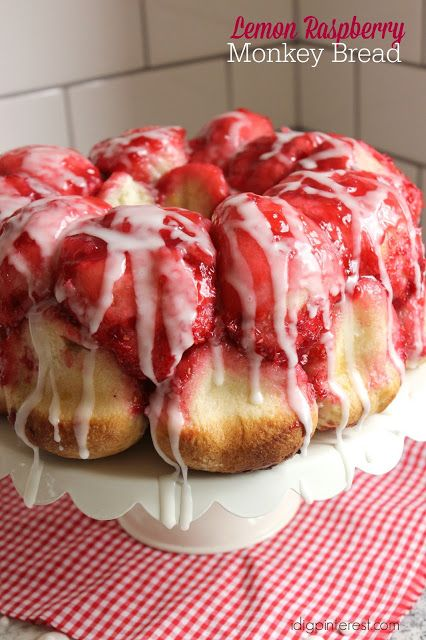 """Lemon Raspberry Monkey Bread. This gorgeous red and white """"cake"""" (a.k.a. pull apart bread) made with sticky lemon raspberry sweet buns is begging to be enjoyed!"""