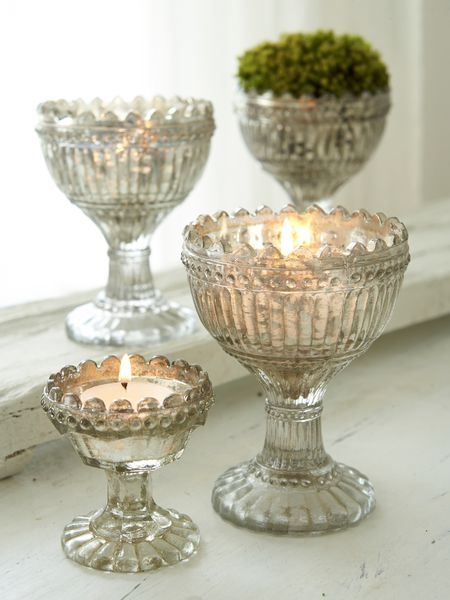These vintage style tealight holders are so lovely. The aged look has been achieved by a special antique silver leaf finish.