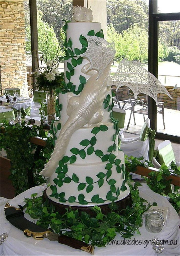 Smaug Dragon Wedding Cake This 5 tier Smaug Dragon cake was made for a beautiful Lord of the Rings themed wedding. The dragon is hand...