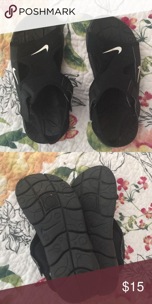 Black Nike water shoes.  Size 1 Black Nike water shoes.  Size 1.  Barely worn Nike Shoes Water Shoes