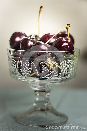 The elegance of fresh cherries in a glass bowl.