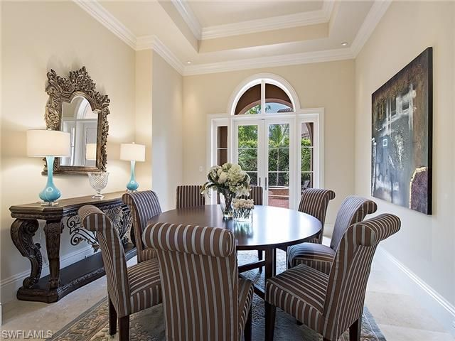Formal Dining Room With Round Table For Eight