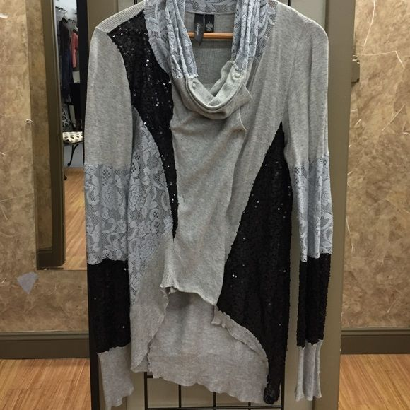 BKE Boutique Slouchy Cardigan Mixed textured snap front slouchy cardigan. Sequins and lace mix together for a super fun look! BKE Sweaters Cardigans