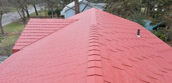 Tamko Metalworks - Red Color metal shingles roof on a ranch house. G-Galvanized steel metal shingles roofing system coated with Kynar 500 paint finish.
