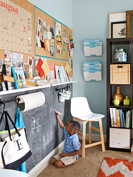 Corkboard up top equals room for a calendar, design swatches, and more; a chalkboard and hooks below offer kid-friendly drawing space.