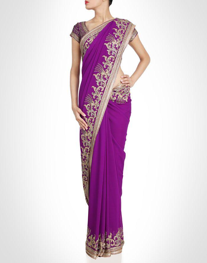 Purple sari encrusted with bugle beads and rhinestones. Shop Now: www.kimaya.in