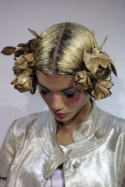 Like the styling of the hair with the floral piece and then the painting.  Could be very statuesque.