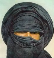 "The Tuareg are Berbers who live in the Maghrib. They are sometimes called the ""blue people"" as the blue indigo dye from their clothing rubs off onto their skin. Men are veiled but women never are."