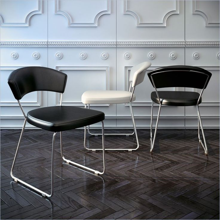 Modloft Delancy Dining Chair in Black Leather - The ultra-modern Delancy dining chair brings a stylish contemporary flair to your dining room. With a cool combination of steel frame and black leather upholstery, this dining chair is balances originality with ergonomic design.