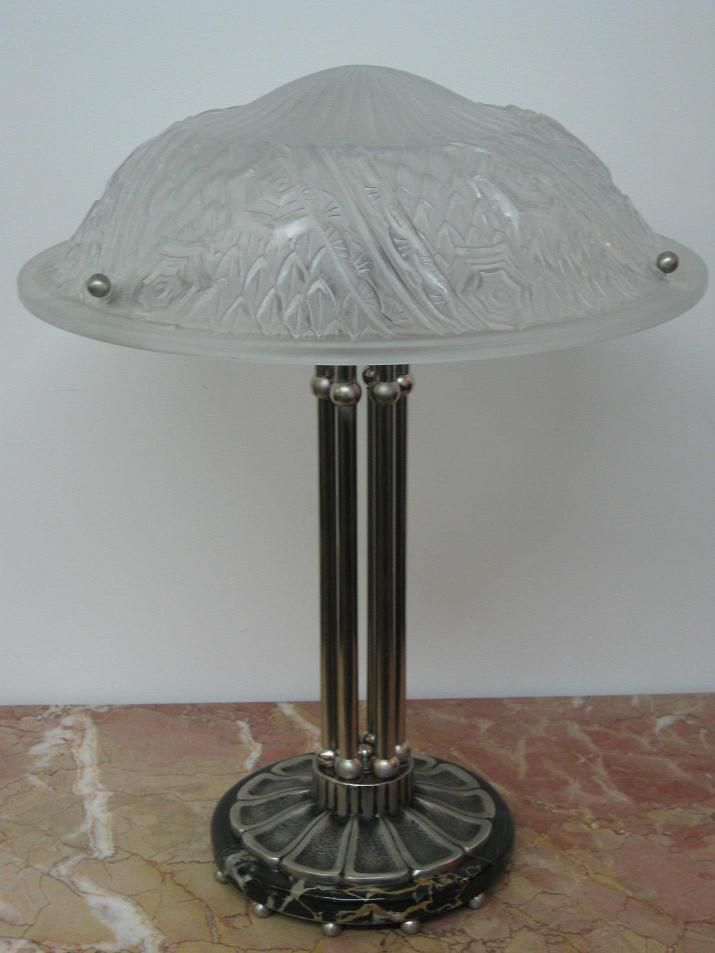 """A pair of French Art Deco Table Lamps signed by the French artists """"Muller Frères Luneville"""" in clear frosted molded Glass Shades enhanced by intricate geometric flower motif with polished details. Six stems with ball ornamental design with a round flower petals base on Porto Marble base in satin Silver Bronze and Black patina.  Reference #: TL8706  Measurement: Height: 21 in. (53.34 cm) Diameter: 15.5 in. (39.5 cm) Shade Height: 5 in. (12.70 cm) Diameter: 15.5 in. (39.5 cm)"""