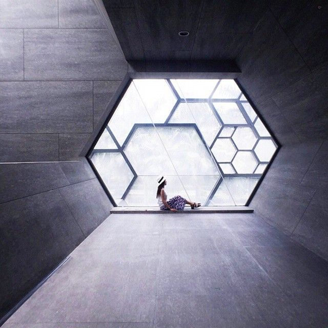 Some architects have an obsession with zany geometries--and Urbanus Architecture and Design in China is no exception! For the OCT Art & Design Gallery in Shenzhen, the firm framed the exterior in a series of hexagons in steel and wrapped in glass. But the theme doesn't stop on the outside--concrete hallways continue in the six-sided shape! #china #shenzhen #geometry... - Interior Design Ideas, Interior Decor and Designs, Home Design Inspiration, Room Design Ideas, Interior Decorating…