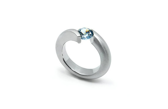 The Latest ring design by Maison Taormina. Brushed and Polished finish Stainless Steel Ring, with Tension Set round Blue Topaz. Also availabe upon request with: White Topaz, Pink Quartz, Amethyst, Yellow Topaz, Garnet, Back Onyx and Peridot. Ideal for Engagment ring - by Taormina Designs on Etsy, $240.00