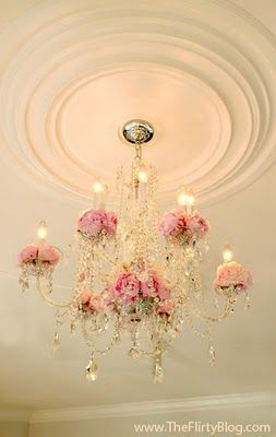 J'adore chandeliers decorated with flowers...one of the nicest pieces in the room..a centerpoint, really.....highlight