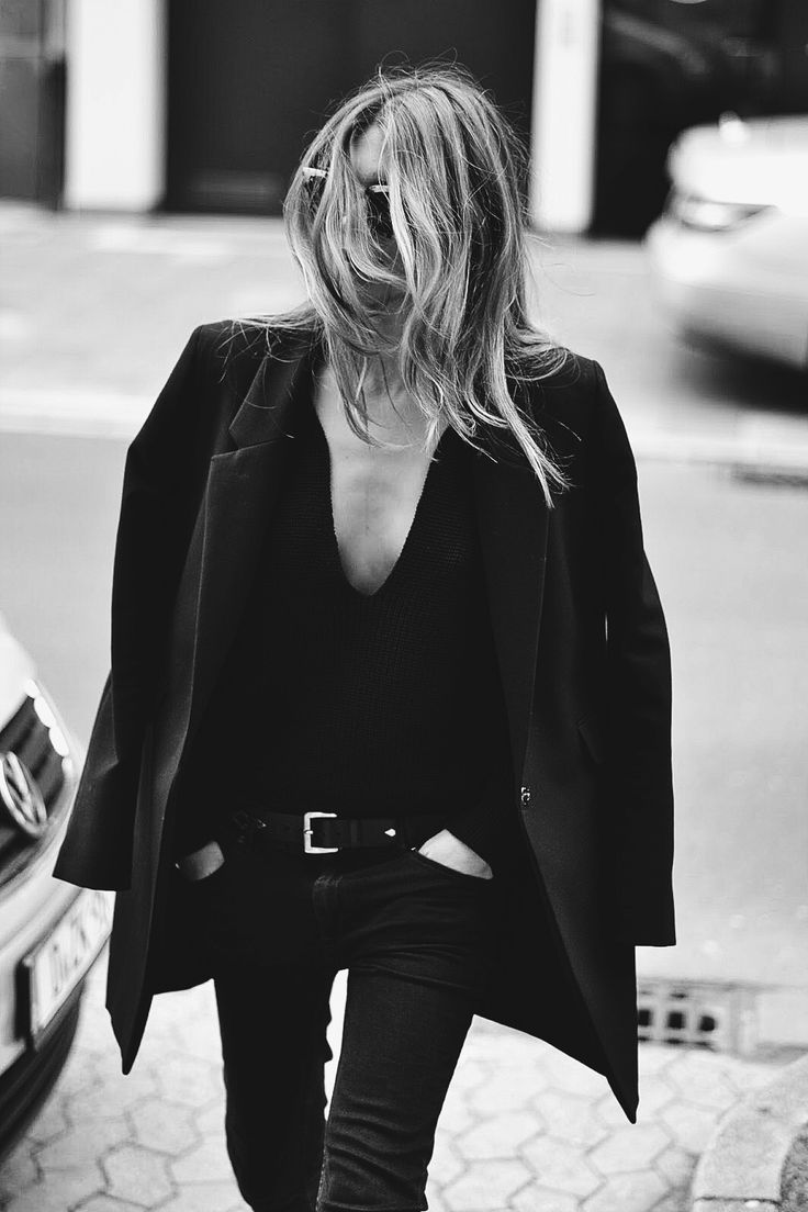 All-black look with soft tailoring and fitted denim