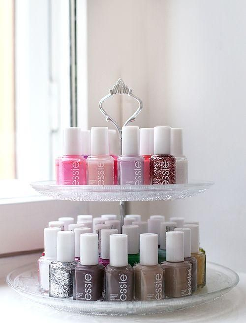 Great way to store and organize your nail polish! Use a cake stand your favorite nail colors.