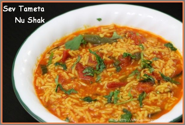 Sev Tameta Nu Shak / Sev Tamatar Sabji recipe is one of my all time favorite Gujarati sabzi/curry. Sev Tameta Nu Shak as it's called in Gujarati is a sweet and sour curry made from tomato, sev and spices. This curry is often eaten with Gujarati Bhakhari or Rotla. This curry is very easy and hardly takes few minutes to prepare. You can prepare Sev at home or you can buy it from any Indian Grocery store. This curry requires slightly thick Sev. There are variety of Sev you may find in the…