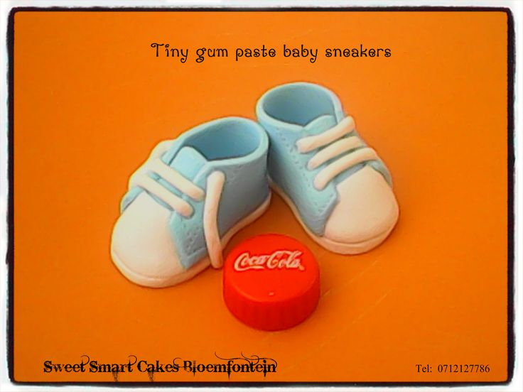 Tiny gum paste baby sneakers For more info & orders, email SweetArtBfn@gmail.com or call/whatsapp 0712127786 (CAKE DECORATING CLASSES AVAILABLE)